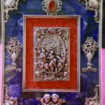 Una cornice e un candelabro Faberge