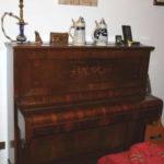 Vecchio pianoforte da conservare