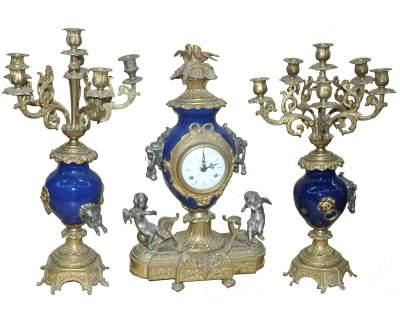 Trittico candelabri e orologio decorati a smalto